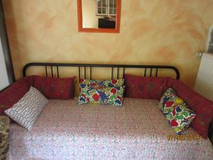 A bed or beds in a room at La Muria Apartment