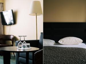 En eller flere senge i et værelse på Herløv Kro Hotel