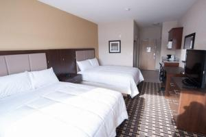 A bed or beds in a room at Western Star Inn & Suites Esterhazy