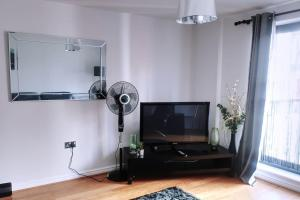 A television and/or entertainment center at Apartment On d'Ring