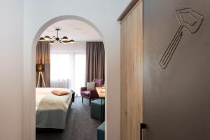 Ein Bett oder Betten in einem Zimmer der Unterkunft Hotel Hörterer Der Hammerwirt