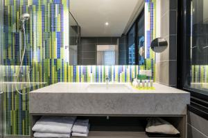 A bathroom at Capri by Fraser Brisbane