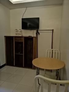 Televiisor ja/või meelelahutuskeskus majutusasutuses Cliffside Cottages