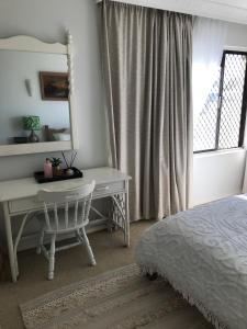 A bed or beds in a room at Banadero Beach Holiday Magic