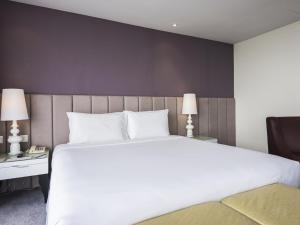 A bed or beds in a room at Silka Cheras Kuala Lumpur
