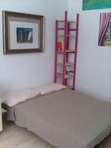 Letto o letti in una camera di Flat in Genova