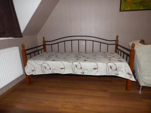 A bed or beds in a room at Borjomi Apartment Erekle Street