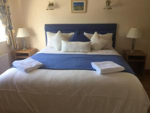 A bed or beds in a room at Teach Na Coiribe B&B