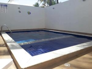 The swimming pool at or close to Flat São Miguel dos Milagres