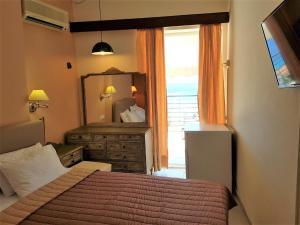 Un ou plusieurs lits dans un hébergement de l'établissement Mitho Hotel