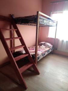 A bunk bed or bunk beds in a room at Абажур