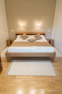 Ein Bett oder Betten in einem Zimmer der Unterkunft Gartenlodge Auszeit