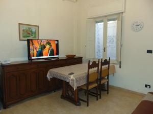 TV o dispositivi per l'intrattenimento presso Ravagnese House