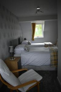 A bed or beds in a room at Monturpie Guest House