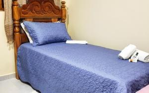 A bed or beds in a room at Recanto Alto da Serra