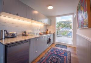 A kitchen or kitchenette at Akaroa Waterfront Apartment