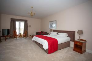 A bed or beds in a room at Links Country Park Hotel