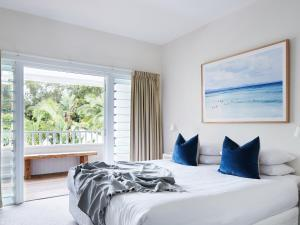 A bed or beds in a room at Atlantic Byron Bay