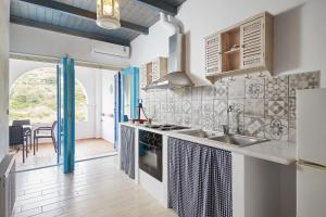 A kitchen or kitchenette at Kerame Studios & Apartments