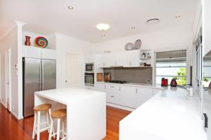 A kitchen or kitchenette at STUNNING BEACHSIDE HOLIDAY HOME