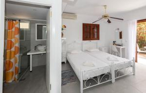 A bed or beds in a room at Galini Studios & Apartments
