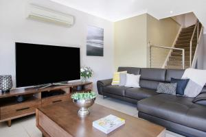 A television and/or entertainment center at Cypress Townhouse 21 - Mulwala