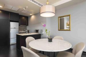 A kitchen or kitchenette at Chatrium Hotel Riverside Bangkok