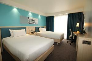Cama ou camas em um quarto em Hampton By Hilton London Docklands