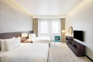 A television and/or entertainment centre at Hyatt Place Dubai Wasl District Residences