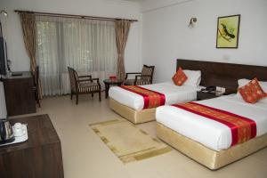A bed or beds in a room at Buddha Maya Garden by KGH Group