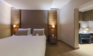 Кровать или кровати в номере Hotel Arcadia Blue Istanbul