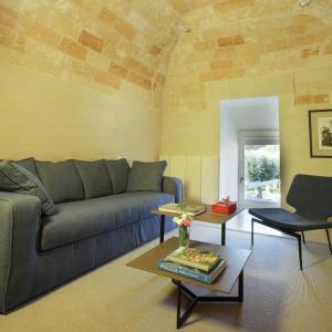 A seating area at La Fiermontina - luxury home hotel