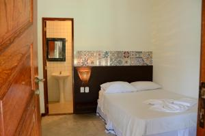 A bed or beds in a room at Aquario Pousada Hostel - Night Club