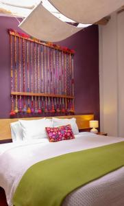 A bed or beds in a room at Casa de La Chola