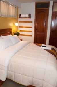 Un ou plusieurs lits dans un hébergement de l'établissement Picos House