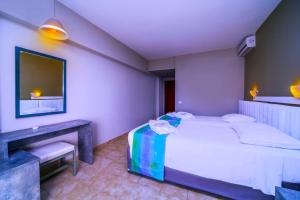 A bed or beds in a room at Lito Hotel