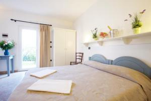 Letto o letti in una camera di La Rossola Resort & Natura
