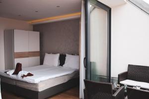 Ein Bett oder Betten in einem Zimmer der Unterkunft Aurellia Serviced Apartments