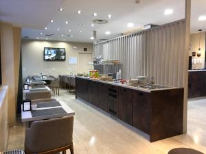 A restaurant or other place to eat at Oasi Village Hotel
