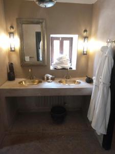A bathroom at The Capaldi Hotel & Spa