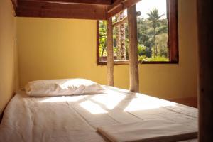 Cama ou camas em um quarto em Hostel Fazenda Itamambuca