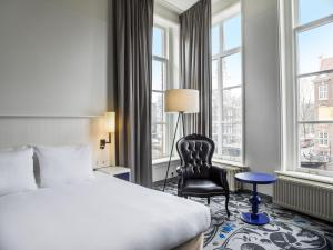 A bed or beds in a room at Radisson Blu Hotel, Amsterdam City Center
