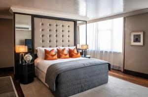 A bed or beds in a room at The Westbury Hotel