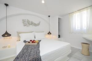 Łóżko lub łóżka w pokoju w obiekcie Maroussa Studios