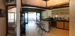 A kitchen or kitchenette at Tropical Village Flat