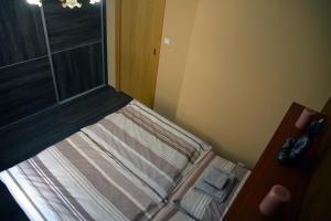 Ein Bett oder Betten in einem Zimmer der Unterkunft Buddha Apartment