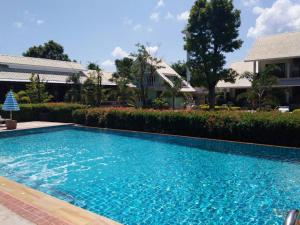 The swimming pool at or near Scent of Sukhothai Resort