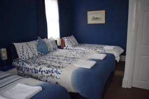 A bed or beds in a room at Gatwick Castle B&B