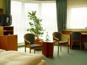 Ein Sitzbereich in der Unterkunft Hotel Stadt Naumburg
