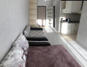 A bed or beds in a room at улица Береговая 61/1б Апартаменты Набережная